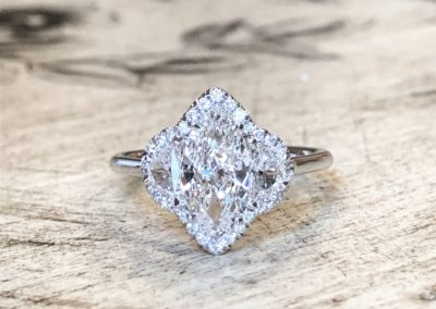 Three Stones Halo Marquise Cut